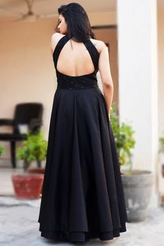 Perfectly cut, this Solid Black Color Padded Double Flair Dress with beautifully embroidered bodice from Colorauction exudes feminine charm. Crafted from cotton silk, this dress will keep you comfortable throughout the party. Saree Blouse Neck Designs, Dress Neck Designs, Fancy Blouse Designs, Lehenga Designs, Long Gown Dress, Lehnga Dress, Indian Gowns Dresses, Indian Fashion Dresses, Party Wear Dresses