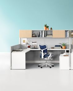 A contemporary Action Office System with Tu Storage.