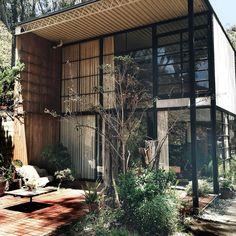 The Eames house from outside the living room. They surrounded themselves with space light and nature