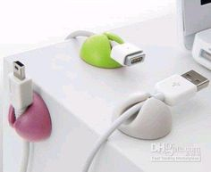 OOH!  I SOOO need these on my desk!  I fish for cords every morning!  :)  Wonder if I could make them out of Sculpey?