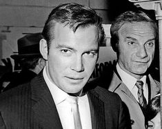 That is Dr. Zachary Smith behind captain kirk. Captain Kirk found the Jupiter II, if anyone could Kirk would. (William Shatner and Jonathan Harris)