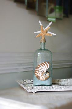 vintage sea shore decorations   Beach Decor Vintage Aqua Glass Bottle with Two Starfish and Nautilus ...