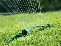 Choose a hose-end sprinkler for a small-to-medium size lawn area. Check out different types of sprinklers to find the one that suits your lawn shape best. This traditional sprinkler waters in a rectangular pattern. Don't forget to turn off a manual sprinkler. Set an oven timer to help jog your memory and conserve water. With all lawn watering, deeper, less frequent irrigation is best. This encourages grass to grow deep roots, which is one secret to growing a healthy, low-maintenance lawn.