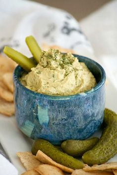 Dill Pickle Hummus is the perfect way to satisfy your craving. Chickpeas, dill pickles, and tahini make this a healthy snack you'll have trouble sharing. Homemade Ham, Homemade Pickles, Appetizer Dips, Appetizer Recipes, Dip Recipes, Recipies, Vegan Recipes, Vegan Snacks, Healthy Snacks