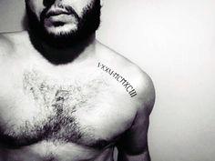 Collar Bone Black Ink Roman Numeral Tattoo On Male