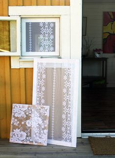 Window screens - ornate curtain lace mounted over timber window frames.  You could use these window screens as wedding or party decor near your guest book or cake table. Love!