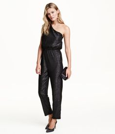 Check this out! Jumpsuit in glittery plumeti chiffon with one softly draped shoulder. Elasticized seam at waist, tapered legs, and concealed side zip. Lined. - Visit hm.com to see more.