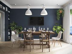 A mismatched dining room with wooden table and chairs the navy blue wall and the white ceiling. Very nice atmosphere rnrnSource by Wooden Table And Chairs, Dining Table, Mismatched Dining Room, Living Place, Web Design, House Design, Design Ideas, Scandinavian Living, Blue Walls