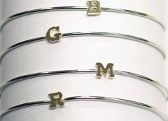 Love these sterling silver and 14kt yellow gold initial bangle bracelets. Stack 'em up! Order by Nov 22nd to guarantee Christmas delivery. Call Gemma Collection at 469 232 9357.