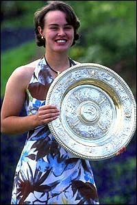 Martina Hingis poses with the Wimbledon trophy