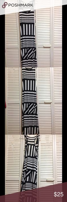 Gorgeous black and white long maxi dress Super cute black-and-white long maxi dress with a racer back. Purchased at Miami boutique worn with love 1x. Dresses Maxi
