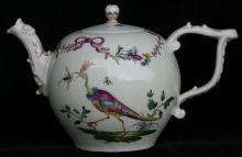 Meissen teapot and an associated cover enamelled w Ref: R626  Meissen teapot and an associated cover enamelled with birds and butterflies beneath garlands of flowers tied with a pink ribbons, blue cross swords, circa 1760. condition: foot rim small line.