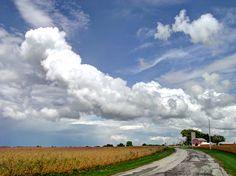 Little farm, big clouds.