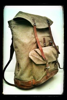 Vintage 'salt & pepper' swiss army canvas and leather rucksack - a classic.