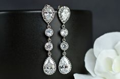 Bridal Earrings Cubic Zirconia Ear Posts, Cubic Zirconia Connectors and Large Cubic Zirconia Crystal Tear Drops. $32.00, via Etsy.