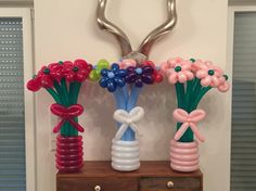 Jewel magenta and jewel green - Rainbow, cloud white, and sky blue - Soft pink and jewel green balloon flower bouquets.