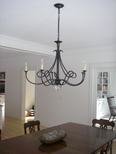 Visual Comfort's Twist chandelier in bronze adds a lovely silhouette in this classic styled home.  Mid-Coast Maine
