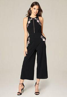 Posh jumpsuit in a halter cut and culotte silhouette. Beautiful floral embroidery. Front openwork flashes a little cleavage. Sexy open back. Front slash pockets. Back neck button-loop closures. Hidden back hook-and-eye and zip closure. Partially lined.
