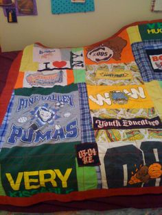 "I created a patchwork quilt of my girls' T-Shirts and Pajamas.  You know, the clothes your kids considered their ""favorites,"" or those that had special meaning to them at that time.  It was a fun way to hang onto those memories at a glance rather than tossing them in the trash or sending them to Goodwill."
