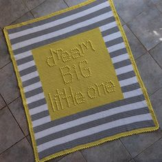 """Dream Big Little One"" baby blanket is worked all in one piece in single crochet (sc), with bobble stitches worked to create the raised letters."