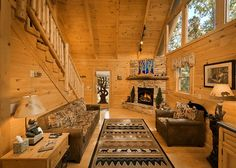 The Treehouse -- Walk into a great room that includes a stone fireplace, living room, dining area, & full kitchen exquisitely decorated for an amazing vacation to the Mountains