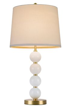 A lovely natural shade tops this playful, Art Deco-inspired table lamp with a slender goldtone pole.