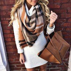 White mini dress with plaid scarf and tan handbag.