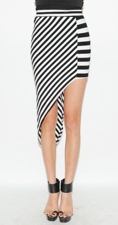 This sexy skirt with asymmetric hem, team yours with simple tank and heels for this weekend clubbing