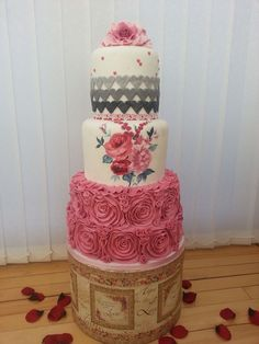 "I love hand painting so wanted to incorporate a gorgeous painting inspired from Laura Ashley to my cake, I also wanted to make the rose ruffle as I think they are so vintage and romantic, the top tier is ombre grey hearts and has script emboss on them in keeping with ""romantic love letters."""
