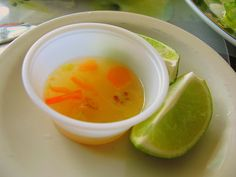FRESH LIME JUICE WITH (HABANEROS) GOAT PEPPER SAUCE.