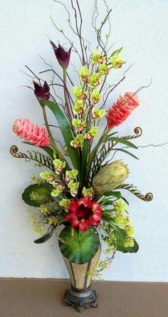 tropical large floral arrangement designed by arcadia floral