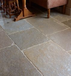 An ultra-hard limestone with a unique, riven surface. Slabs are 'brushed' as they are extracted from the quarry to remove some of the coarseness, making it suitable for both internal and external flagstones.