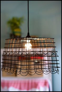 Anthropologie-Inspired Pendant Light : How cool to make a lamp from a wire basket. --I might use this idea to describe the ugly-A lights in the basement!