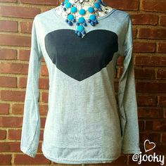 "black heart grey tee super cute grey tee with large black heart graphic. soft, flowy, lots of stretch. brand NWT retail and never worn. fits women's size M/L. bust is about 18"" across when laying flat, about 22"" long from neckline. 100% cotton blend. no trades. Tops Tees - Long Sleeve"