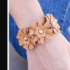 Bracelet Brown leather like bracelet with 3 flowers.    Bundle 5 of my jewelry items for $25 Jewelry Bracelets