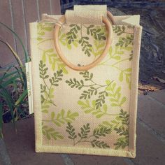 NWT Burlap Leaf Small Tote New with tags and never used burlap leaf small tote with wooden handles. No flaws and great for many purposes. Great for a lunch bag, travel, book bag or a gift bag. Really cute and fun. Bags Mini Bags
