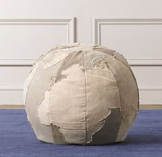 Small World Ottoman: Topographical map of the world. Made of 100% cotton, with an antique map appliqued across each panel.  #Ottoman #Kids #World_Ottoman