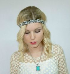 Beaded headband with rhinestones, beads and marquise-cut gemstones. Felt backing and elastic band at base. An intricate beaded headpiece enhanced with subtle sparkling accents and full of unique detail, this headband adds a perfect pop of stylish sparkle to both day and evening looks.  $10