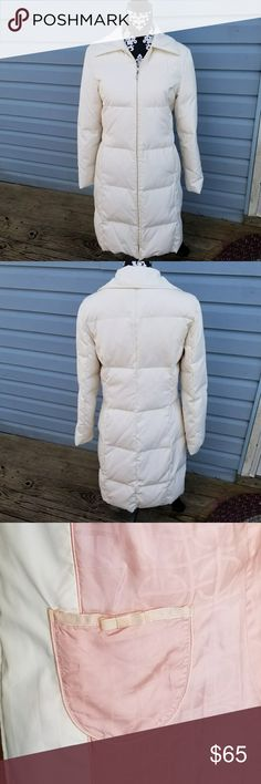 Cole Haan Ivory White Down Jacket Coat Very Nice in Great Condition with No Flaws.  Cole Hann Ivory White Down Puffer Jacket - Size: Small - 80% Down - 20 % Feathers - 100% Polyster Shell - 100% Light Pink Rayon Lining - No Hood Included - 2 Outer Pockets , and 2 Inside Pockets  Measurements:  Arm pit to arm pit: 18 in. Waste: 17.5 in. Sleeve: 21 in. Bottom width: 22.5 in. Top of shoulder to bottom: 36.5 in. Bottom of NECK line to waste: 16 in.  PURCHASE BY 1PM CST AND IT WILL USUALLY SHIP…