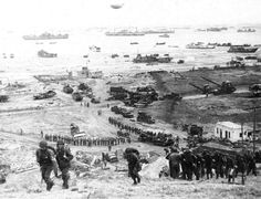 The build-up of Omaha Beach: reinforcements of men and equipment moving inland.