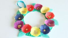 Paper plate flower basket flower basket craft and paper plate crafts make a bright and cheerful wreath for your front door with cupcake liners and a paper plate mightylinksfo