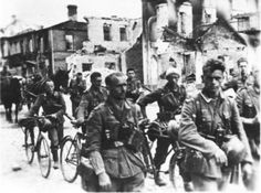 German bicycle troops trudge through the ruins of unidentified Russian town during the opening phase of Barbarossa, June 1941. The advance was so rapid that German formations on foot literally exhausted themselves within two weeks of crossing the prewar border.