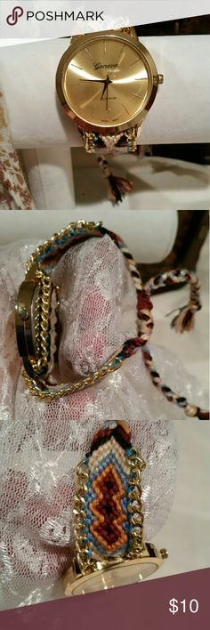 """Watch on woven strap This beautiful watch has a colorful strap that includes delicate golden chains lining the sides, a big face and lines instead of numbers. Pull strings to adjust. No scratches. Battety works. No tags but never used. 13.5"""" long Jewelry"""