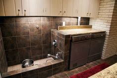 """mudroom dog bath: modify to be a full sized shower, but keep the bottom wall raised. Keep washer/dryer as is and my modified """"lockers"""" with dog kennels underneath opposite."""
