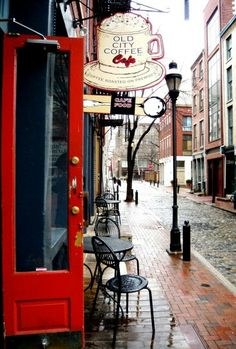 I want to go here. I love the street and everything!! A cup of coffee sitting right on one of those wrought iron chairs