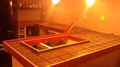 DIY keukenblad, de bekisting zetten met wapening op de kasjes...