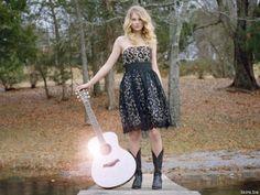 Blonde wig, guitar, black A line dress, cowboy boots, and a surprise face..boom