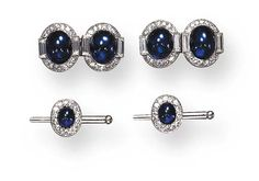 AN ART DECO CABOCHON SAPPHIRE AND DIAMOND DRESS-SET, BY CARTIER   A pair of cuff links, each double link set with a cabochon sapphire, flanked by baguette-cut diamonds, within a single-cut diamond frame, and two shirt studs en suite; mounted in platinum, circa 1925, with French assay marks and maker's marks, in a fitted leather case  Signed Cartier, Paris, No. 07074, M9756  Signed J.C. for Jacques Cartier