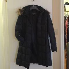 Black Down Coat with detachable Fur trimmed hood Black Down puff coat with detachable fur trimmed Hood and pockets. And front zipper. This coat is knee length and Very Warm. Size Medium Weatherproof Garment Company Jackets & Coats Puffers