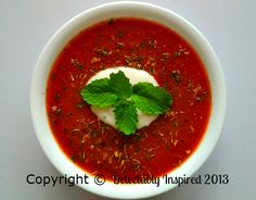 Chilled Gazpacho served with a sprinkling of mixed herbs and sour cream